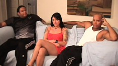 Tattooed brunette has a group of black studs drilling her tight holes