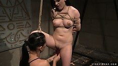 Now that the mistress has made the lesbo slave suck the dildo, she fucks her