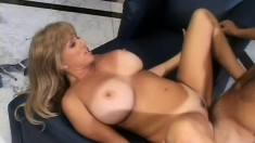 Fascinating blonde cougar with huge boobs loves to ride a hard prick