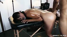 Slutty brunette Dana Vespoli fucked from behind on a masseur table