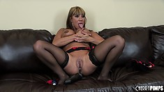 Ava Devine shoves a huge dildo in her kinky ass with great ease
