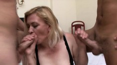 Blonde mature Eliza chews on two dicks and gets some hard fucking