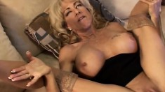 Buxom blonde mom has a tattooed boy devouring and banging her snatch