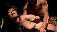 Enchanting brunette smiles as she gets tied up, suspended and fucked