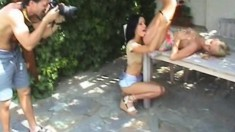 Cindi and Angie take a break outside to toy fuck each other on camera