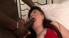 Luscious redhead mature Esmeralda enjoys a big black stick on the bed