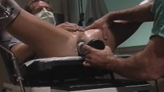 Muscled doctor takes off his scrubs and inserts his gloved fist in a hunky patient's ass