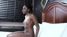 Slender black girl has a big white stick providing infinite pleasure