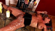 He plays with her tits, then pours hot wax all over her body