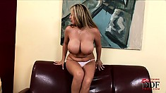 Ho with monster tits rubs her clit and diddles herself with a toy