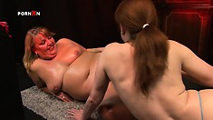 The fat mature lady loves having her friend slowly fisting her tight wet snatch