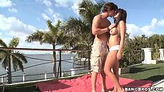 Busty brunette Yurizan Beltran strips down by the beach and blows