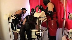 Adela C and a couple of slutty chicks get kinky in latex and face masks