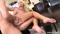 Fake blonde moans as her rough lover holds her down during sex