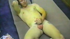 Hot amateur lad rubbing one out to a porn mag in front of the camera
