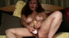 Busty mature lady plays with a dildo and gets fucked hard by two guys