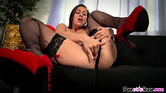 Brunette Rilynn Rae is fingering and sticking them in her wet hole