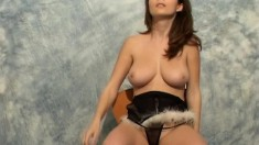 Busty brunette Terri poses and plays with the thing she wants you to fuck