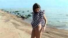 Beautiful girl Kristina gets fully naked and masturbates at the beach