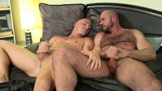 Insatiable stud has two hung boys taking care of his sexual desires