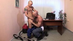 Two experienced gay studs satisfying their anal desires in the office