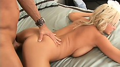 Busty babe gets fucked on her side and then gets it from behind