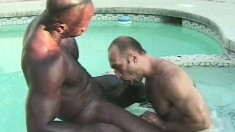 White stud has a muscled black dude fucking his tight ass in the pool