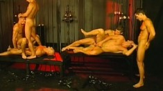 Gay leather daddies meet in the dungeon to bang bareback style